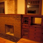 The dining room showcases an original fireplace and built-in cabinets.