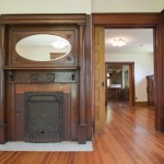 The parlor, featuring an antique fireplace.
