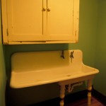 Sink and cupboards in the laundry room.